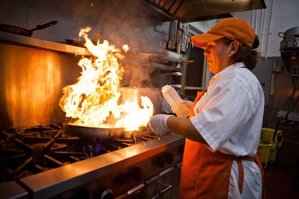Luz Bautista cooks in the Millennium Chicken III