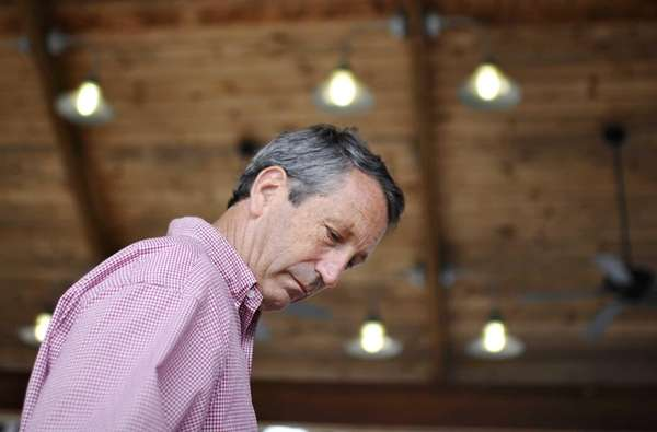 Former South Carolina Gov. Mark Sanford looks down