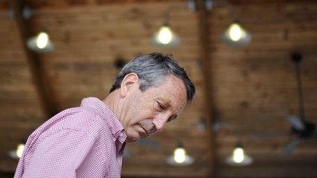 Former South Carolina Gov. Mark Sanford looks down