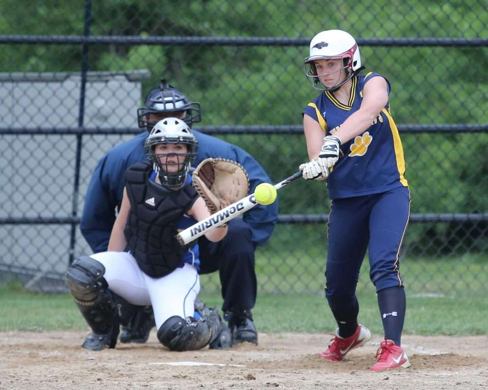 Shoreham-Wading River's Alex Hutchins hits a line drive