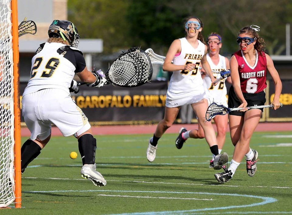 Garden City's Margot McTiernan scores between the legs