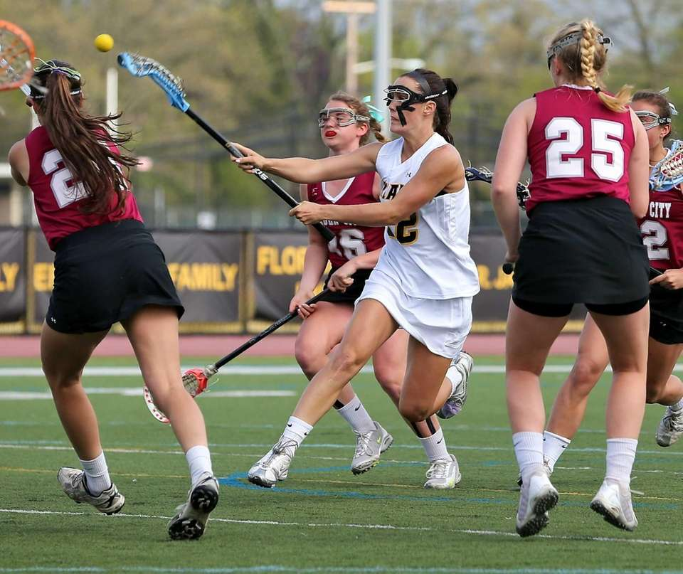 St. Anthony's Maggie Bill shoots and scores against