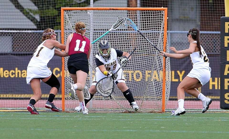 St. Anthony goalie Charlotte Campbell tries to stop