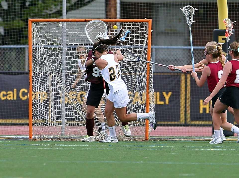 St. Anthony's Maggie Bill snaps the shot past