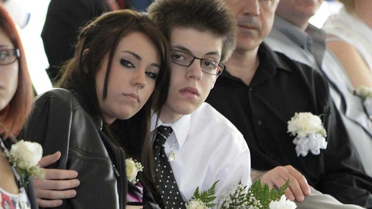 Daniel Oliveri, right, son of deceased Nassau County