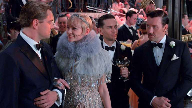 Leonardo DiCaprio as Jay Gatsby, Carey Mulligan as