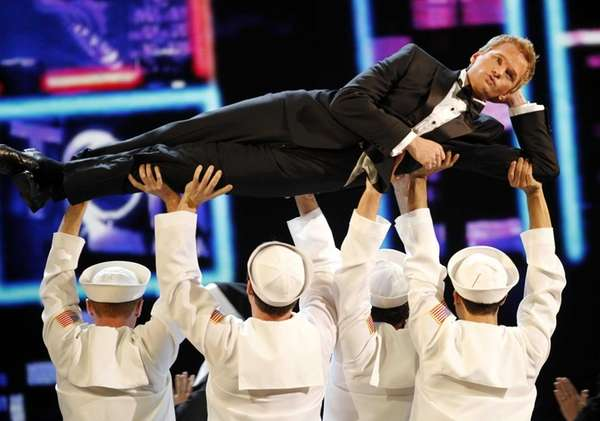 Host Neil Patrick Harris performs during the 65th