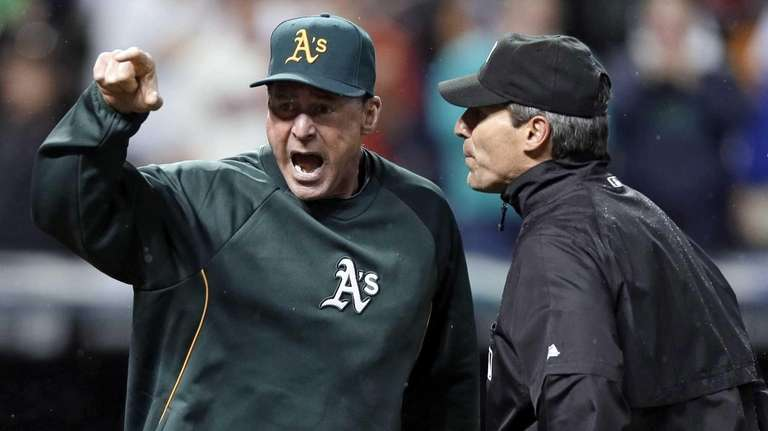 Oakland Athletics manager Bob Melvin, left, argues with