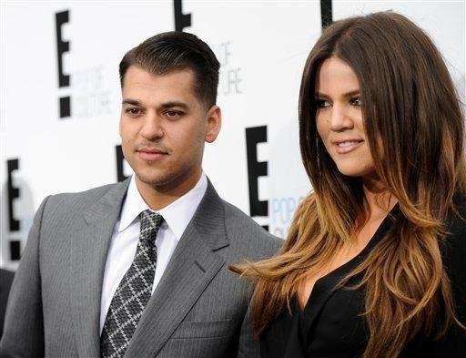 Rob Kardashian and Khloe Kardashian Odom attend an