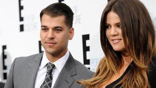 Rob Kardashian and Khloe Kardashian Odom attend an