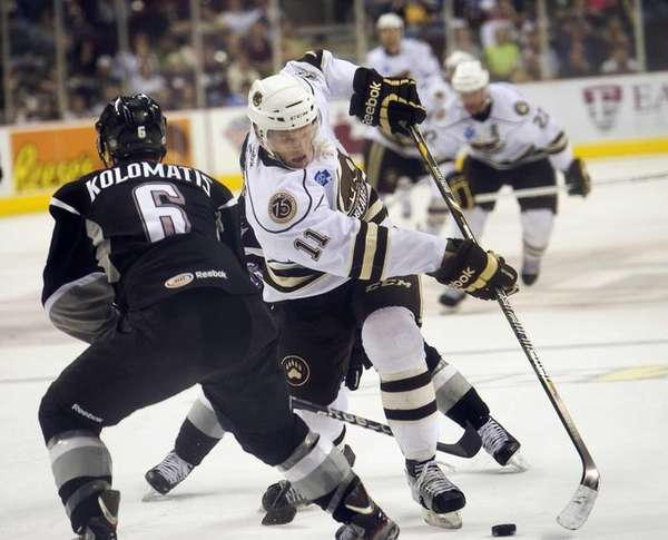 The Hershey Bears' Joey Crabb (11) charges toward