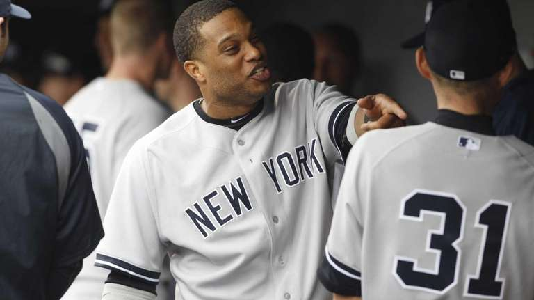 Yankees second baseman Robinson Cano, left, jokes with