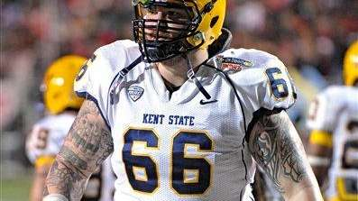 Kent State offensive lineman Brian Winters (66) stretches