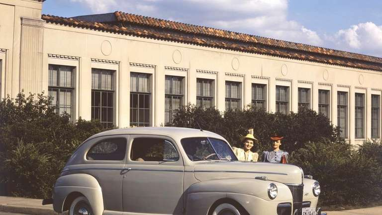 A 1941 Ford Super DeLux Tudor is pictured.
