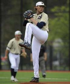 Dowling College starting pitcher Tyler Badamo delivers in