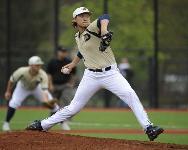 Dowling College starting pitcher Tyler Badamo throws in