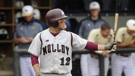 Molloy College's John Galanoudis sets up in the