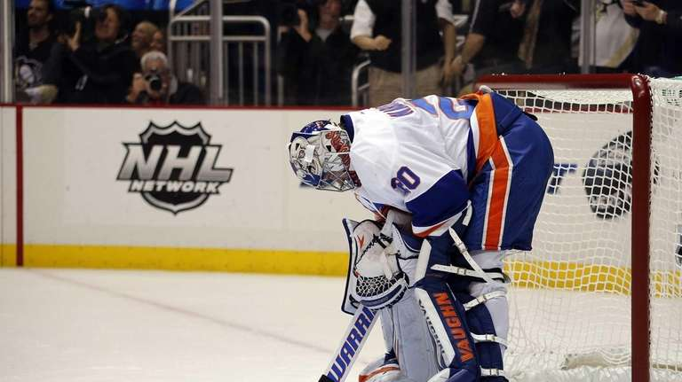 Evgeni Nabokov of the Islanders reacts after giving