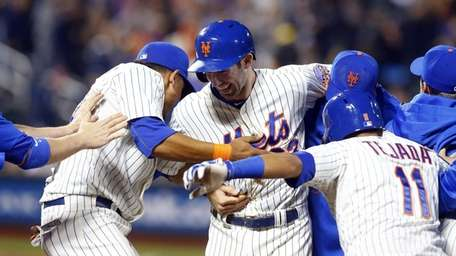 Mike Baxter of the Mets is mobbed after