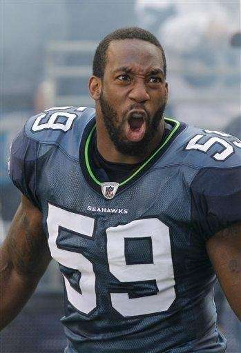 Seattle Seahawks linebacker Aaron Curry takes the field