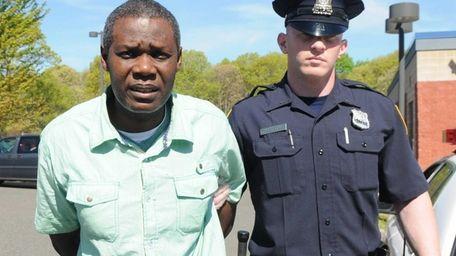 Emmanuel Egbunike, 43, of Brooklyn, is led out