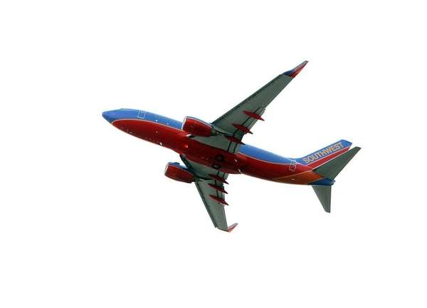 A Southwest Boeing 737 takes off from MacArthur