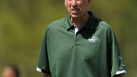 Jets general manager John Idzik surveys the field