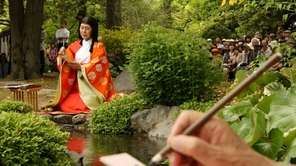 A woman writes Japanese poetry during the Kamo