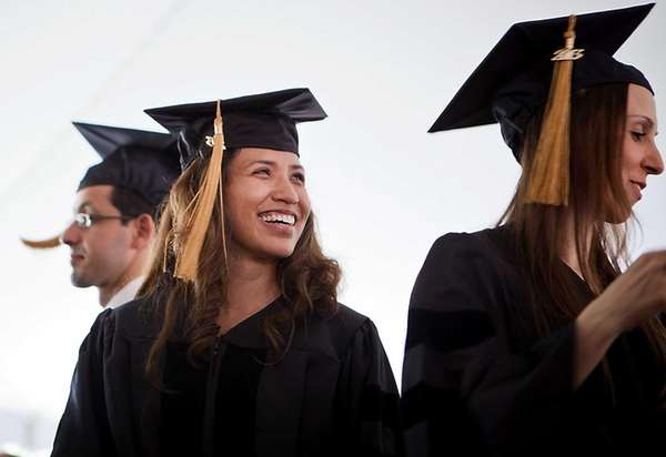 Students attend the graduation ceremony at LIU Post