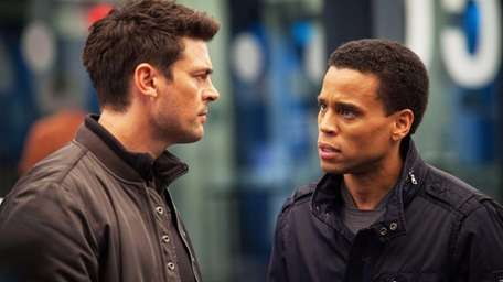 Karl Urban, left, as John Kennex and Michael