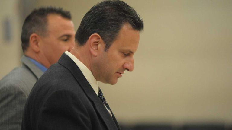 Partner of Peter Figoski, Glenn Estrada, stands in