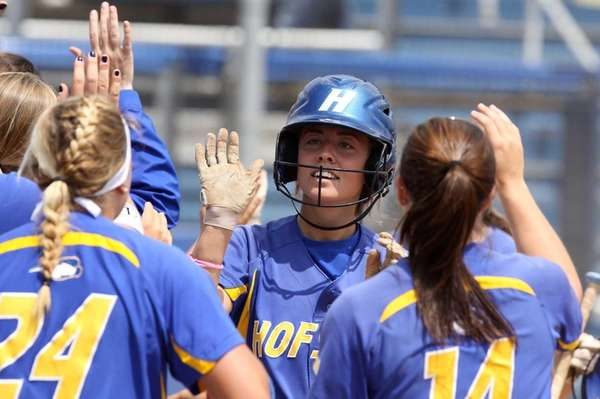 Hofstra's Chloe Fitzgerald receives high fives from teammates