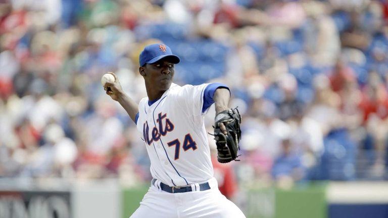 Mets starting pitcher Rafael Montero throws during the