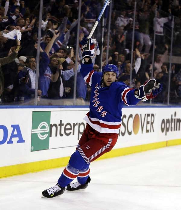 Rangers right wing Ryane Clowe celebrates after he