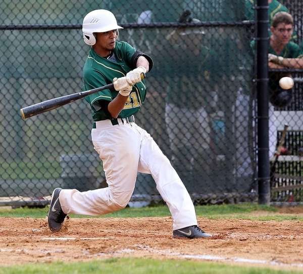 Ward Melville's Chris Cepeda hits a single in