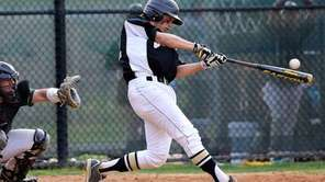 Commack's Jesse Berardi drives the ball to the