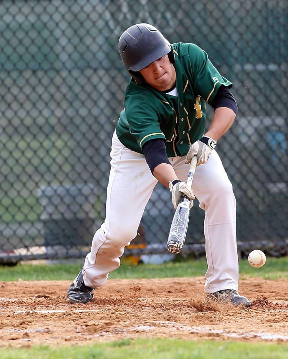 Ward Melville's Greg Coman lays down a bunt
