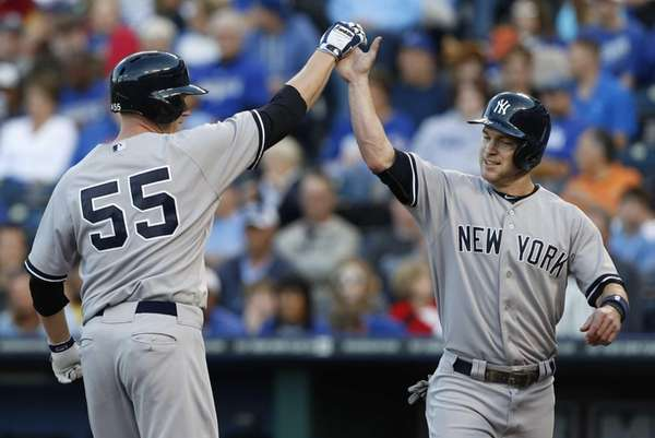 Yankees' Lyle Overbay celebrates his two-run home run