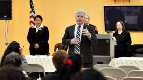 Steve Bellone addresses residents of Huntington Station as
