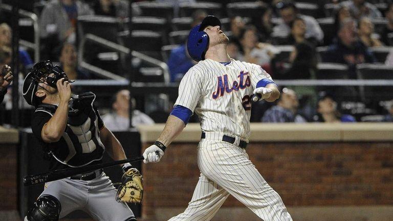 Mets' Ike Davis watches his pop up that