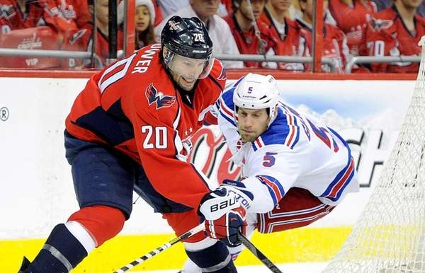Troy Brouwer of the Washington Capitals is defended