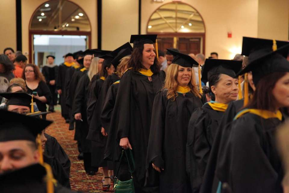 A procession enters the Melville commencement ceremony for