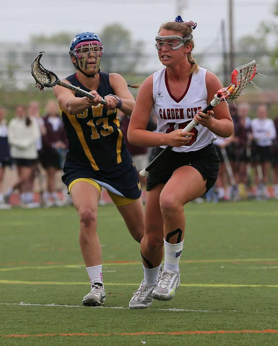 Garden City's Kerry Defliese moves past the stick