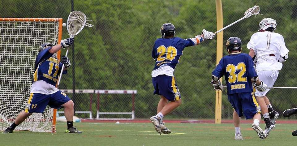 Garden City's Justin Guterding scores on Shoreham goalie