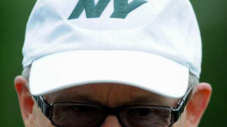 Jets owner Woody Johnson casually speaks to the