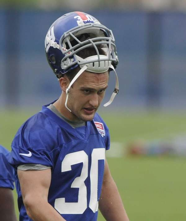 Giants safety Cooper Taylor looks on during rookie