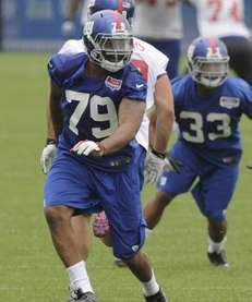 Giants third round draft choice Damontre Moore runs