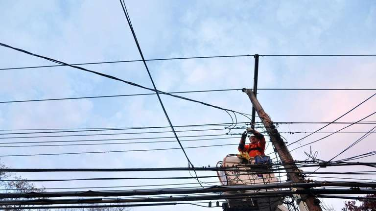 A LIPA subcontracted worker works on restoring power