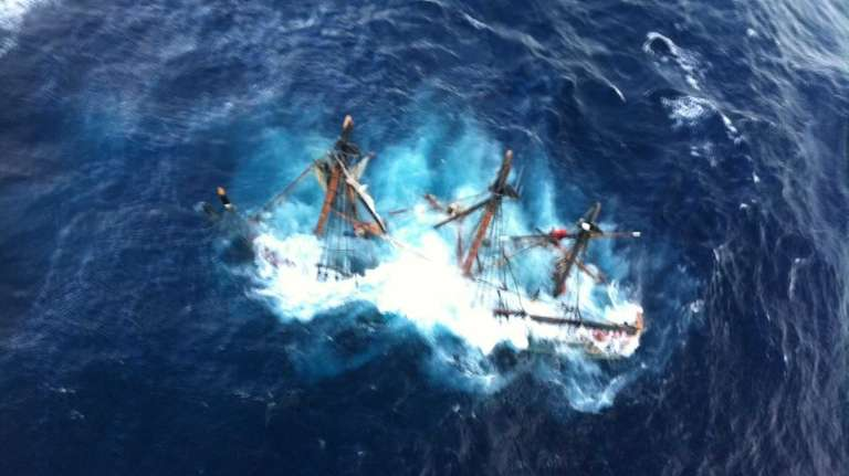 The HMS Bounty, a 180-foot sailboat, gets submerged