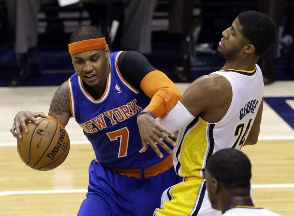 Indiana Pacers forward Paul George, right, gets tangled